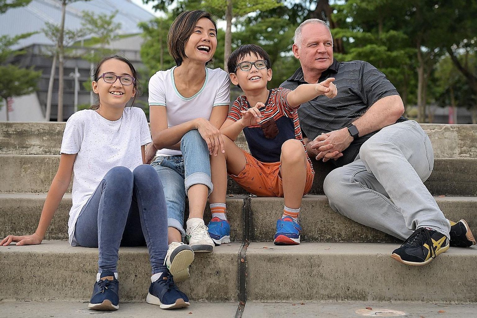 Ms Charlene Tiuson Uy (left), senior associate of advisory services, and legal counsel Fiana Sinha (above), are happy to be back at work after staying home to care for their children. Ms Sharon Teo with husband James Shanahan, daughter Emma and son T