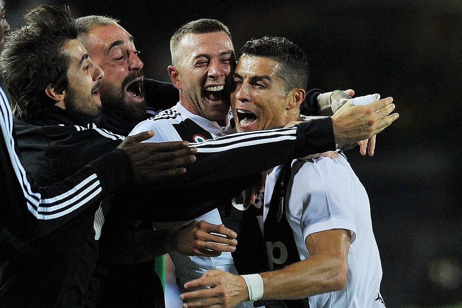 Cristiano Ronaldo celebrating what proved to be the winner against Empoli with his teammates. The Portuguese forward's long-range strike gave the Serie A leaders a 2-1 victory.