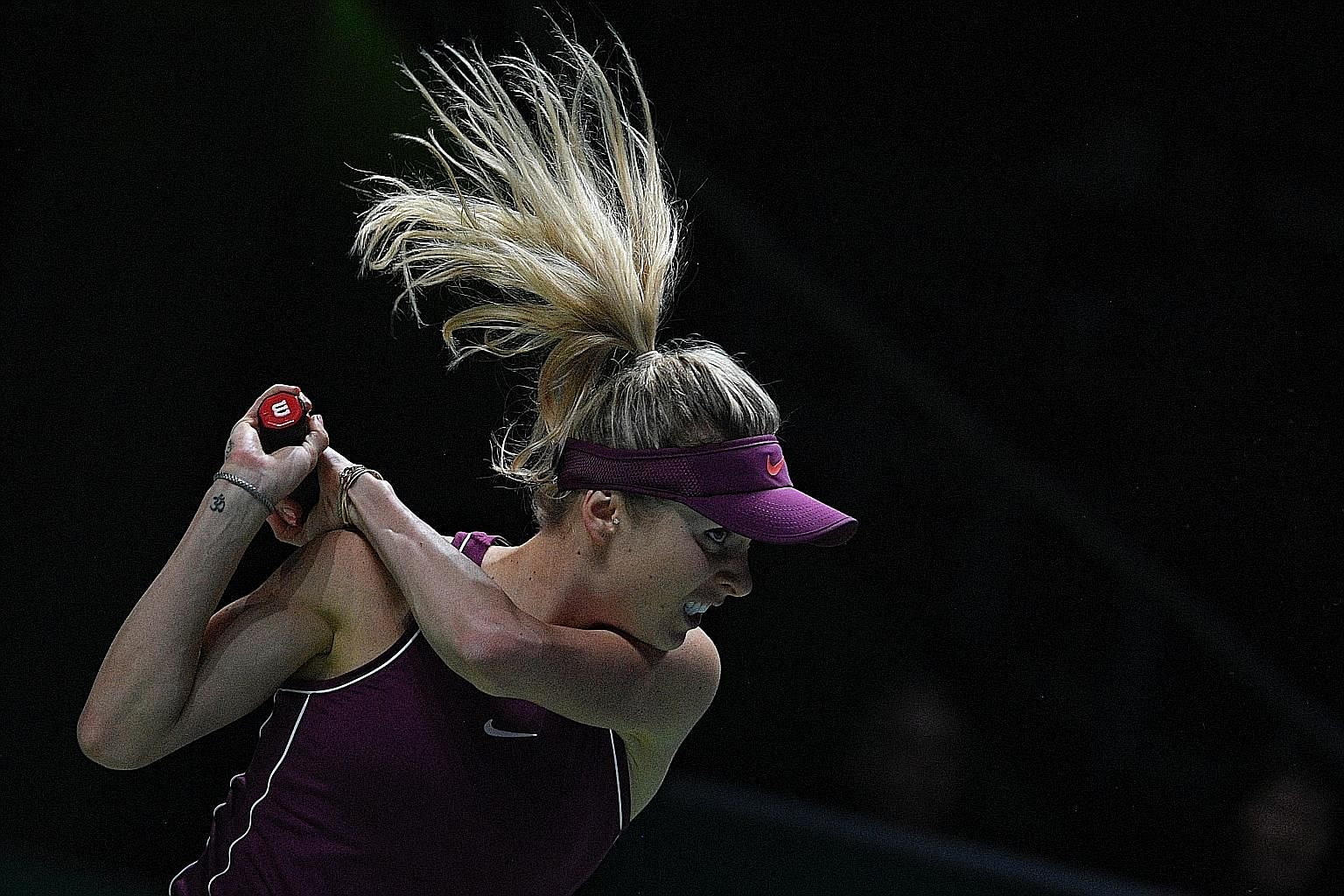 Elina Svitolina's mental toughness is on display in her expression as she hits a return to Sloane Stephens during the final of the WTA Finals yesterday. The Ukrainian dispatched her American opponent in three sets.
