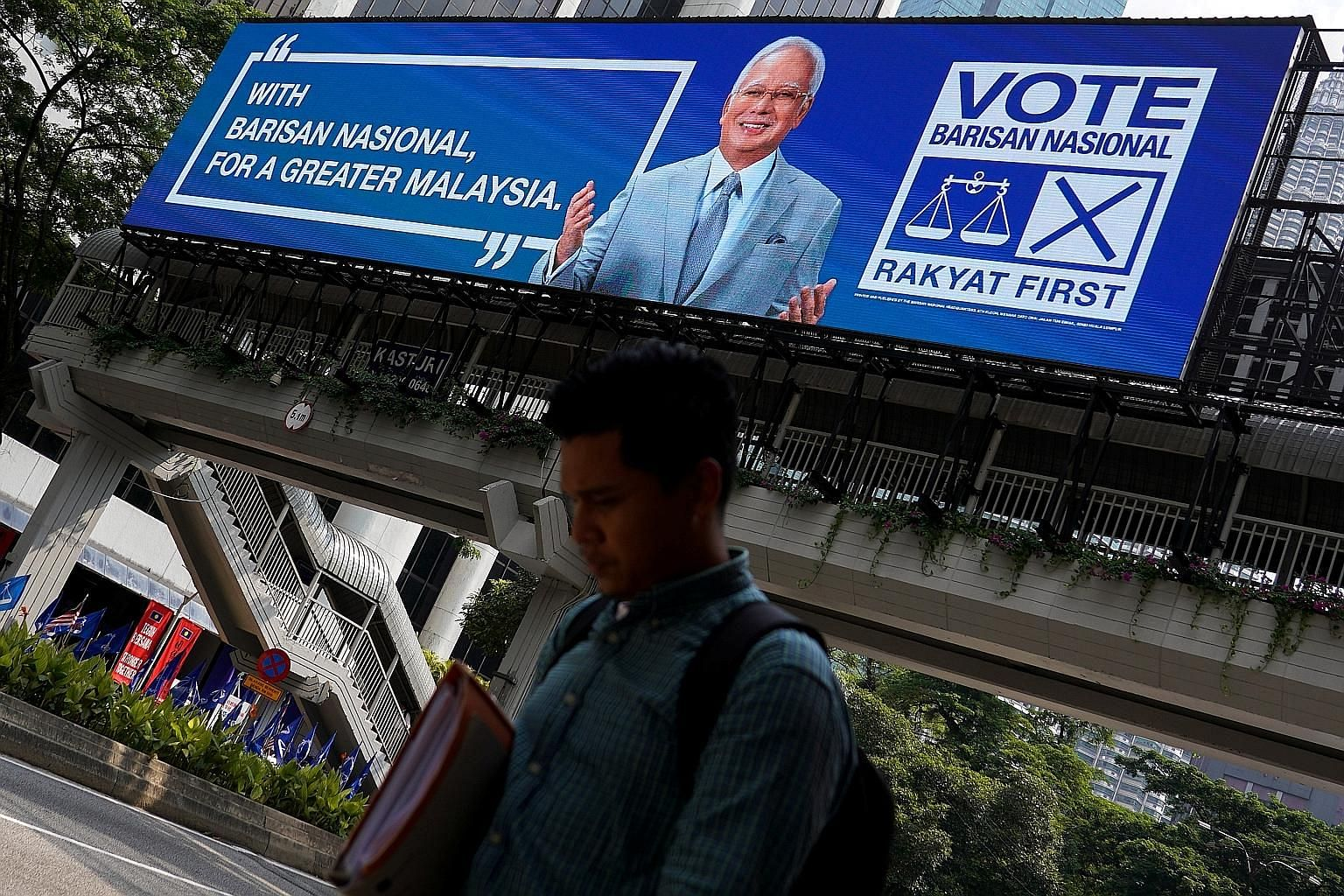 Malaysia's former prime minister Najib Razak and the Barisan Nasional featured on an election billboard this year. BN was popular as a broad-based coalition representing all communities but support waned amid claims of corruption and rising racial te