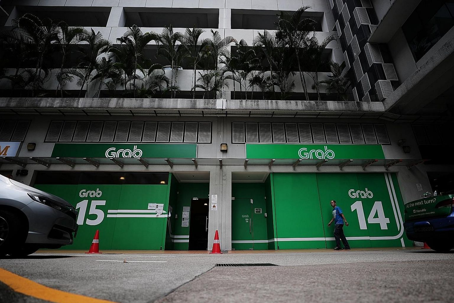 Under ride-hailing company Grab's new programme, a driver who hits 180 trips a week for one month, for example, can earn $10,888, before deducting costs such as rental and fuel. Grab guarantees gross monthly incomes of $6,888 to $11,888.
