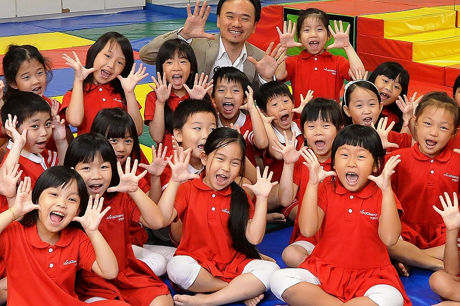 MindChamps founder and chief executive officer David Chiem with some of the pre-school group's children.