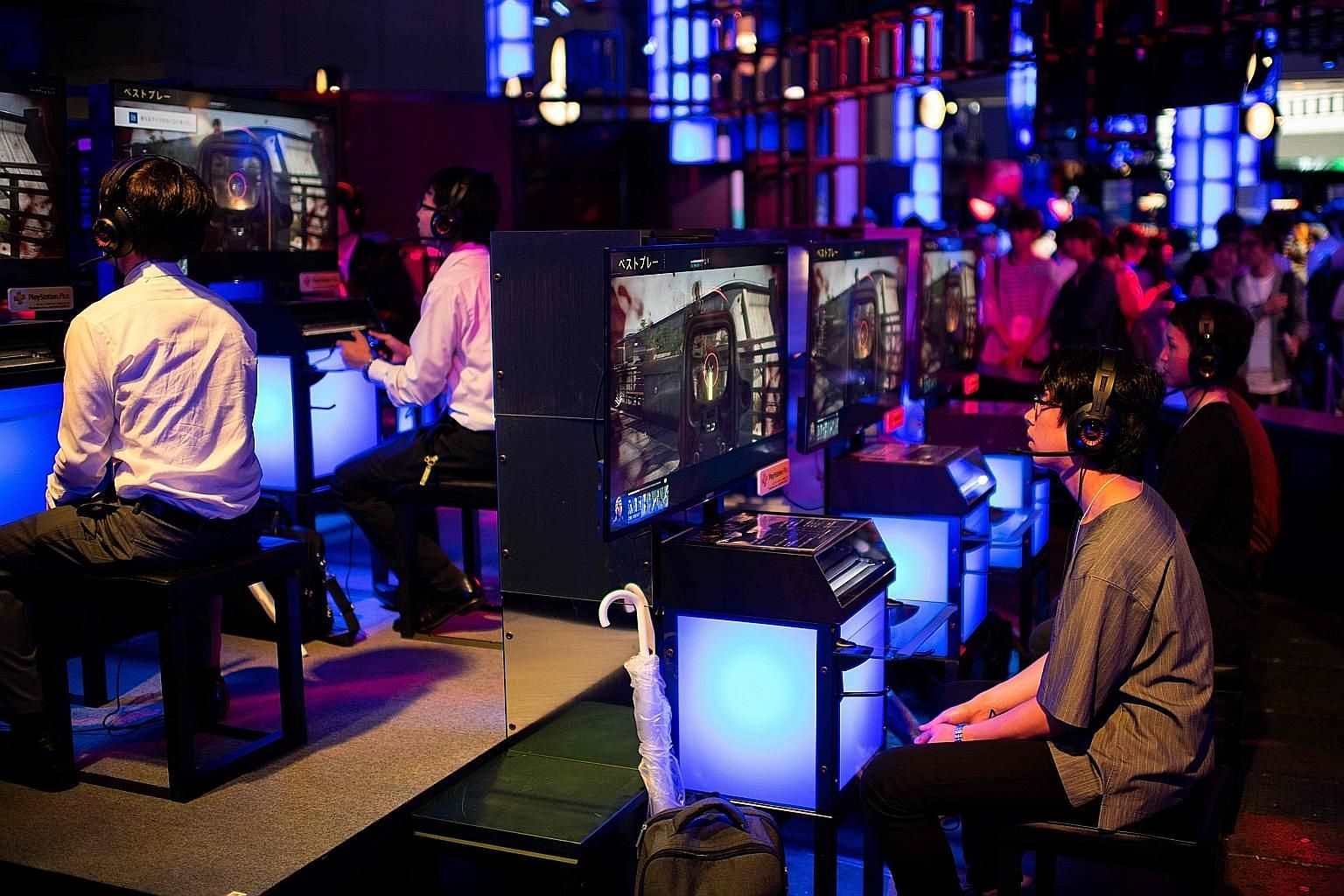 Visitors at the Tokyo Game Show in September playing Sony's video game Call of Duty. The Japanese electronics and entertainment giant yesterday said operating profit and sales were both up, with video games driving the good news.