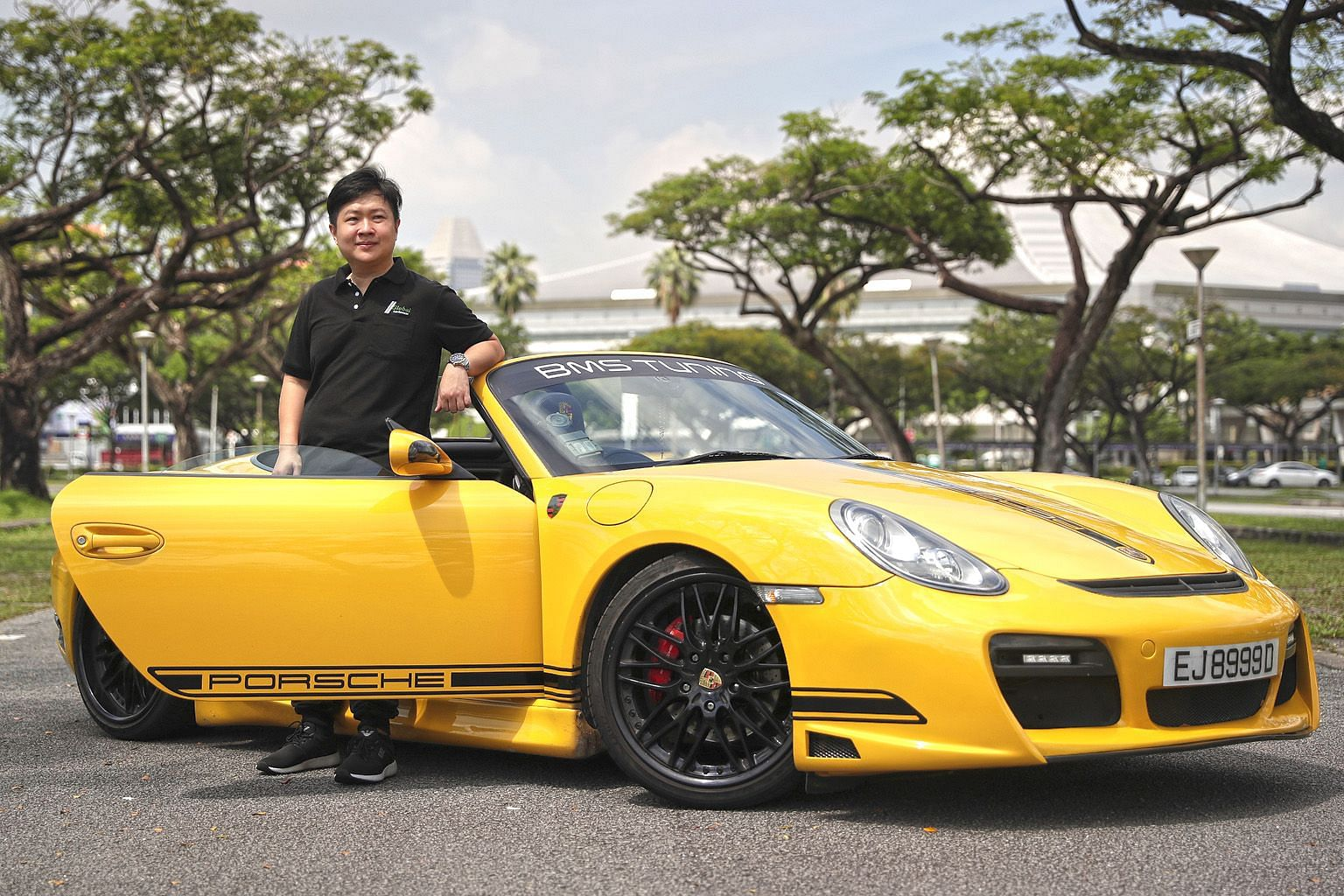 Mr Fed Wu, who runs Allmotoring, with a Porsche being sold on consignment. He said that out of the 30 cars he has in his showroom, 20 are on consignment. In the past, consignment cars made up only 20 per cent of his stock. The cars on consignment are