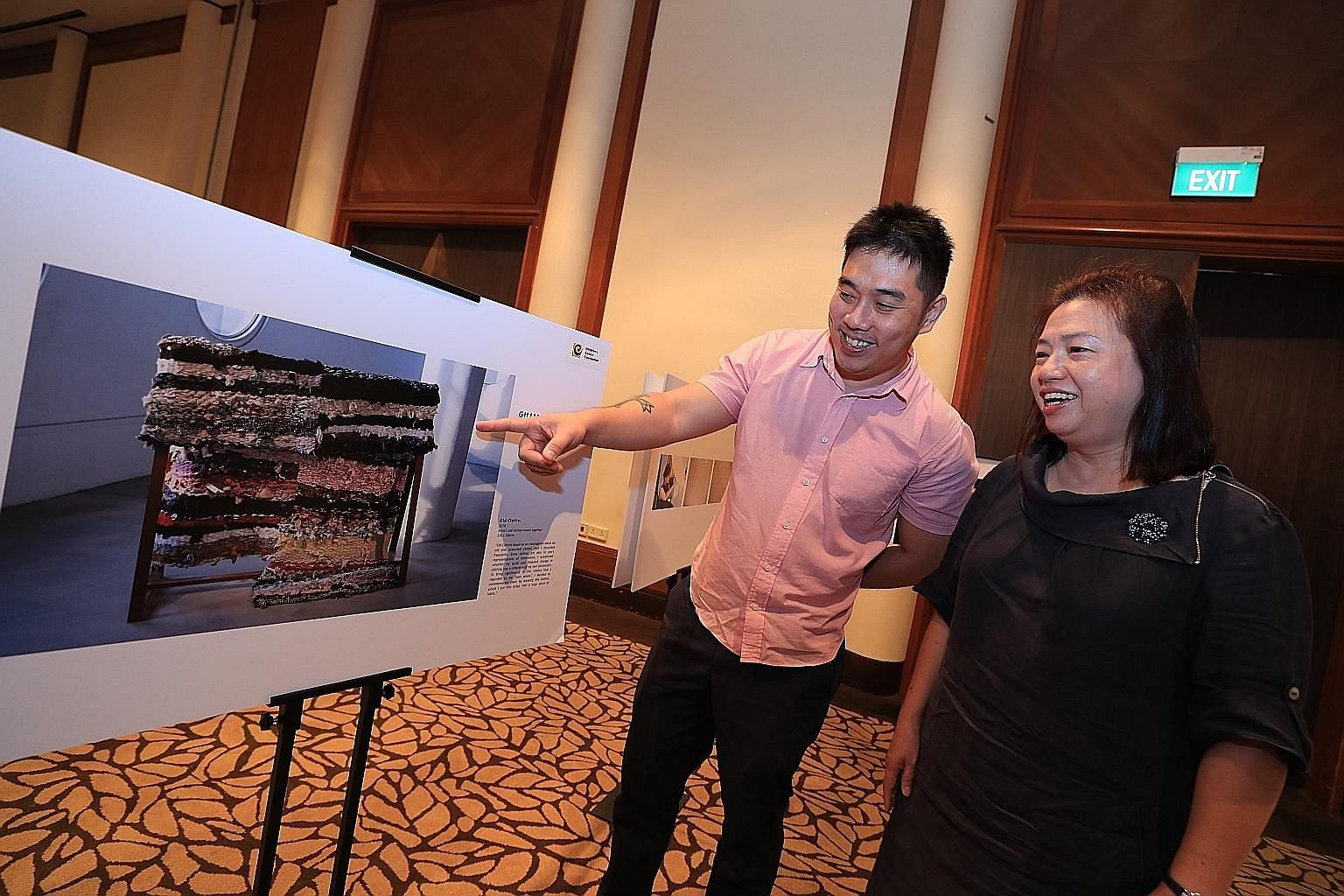 Madam Stephanie Pham, who lost her 20-year-old daughter Gillian Chen to cancer in March, and Ms Chen's teacher from the School of the Arts Singapore, Mr David Gan, with a photo of Ms Chen's artwork yesterday. It was on display at a photo exhibition h