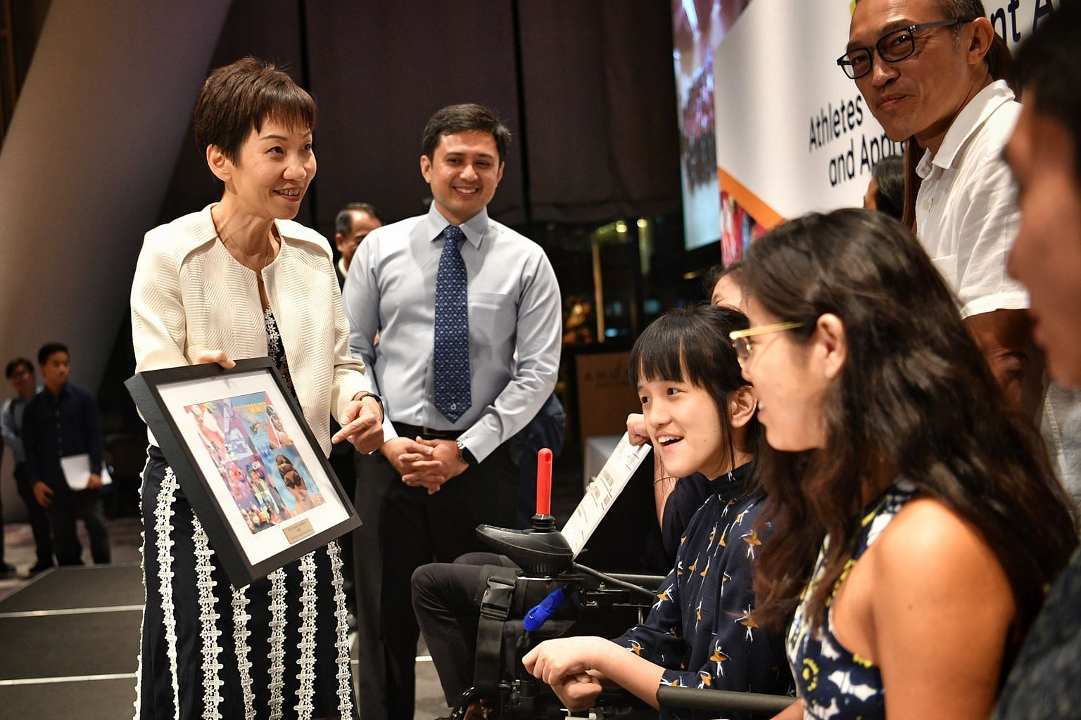 Minister for Culture, Community and Youth Grace Fu with swimmer Yip Pin Xiu (right) and boccia player Faye Lim at last night's awards ceremony.