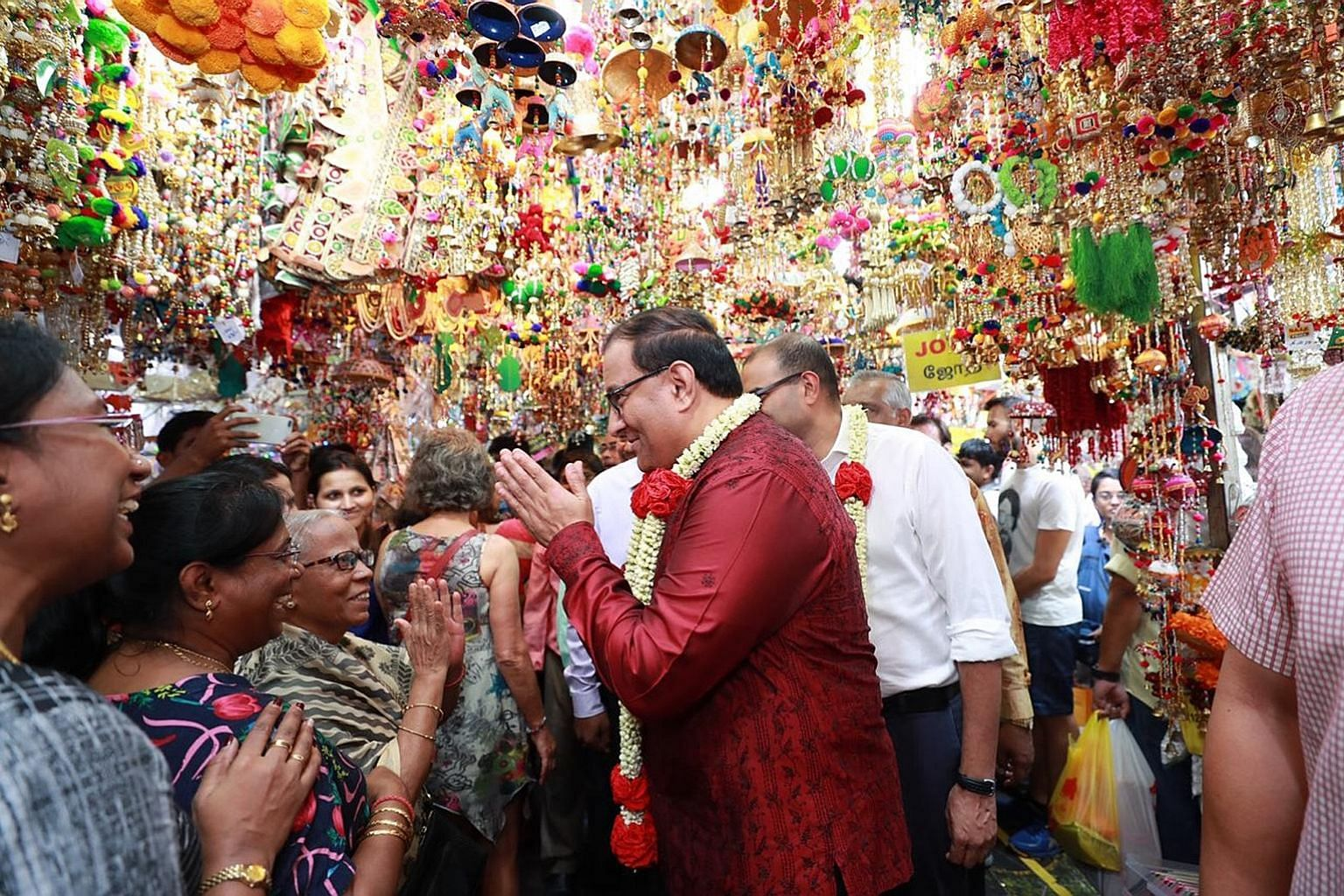 Minister for Communications and Information S. Iswaran paid a visit to the Little India Deepavali bazaar yesterday. While at the bazaar, Mr Iswaran also made donations to the Singapore Indian Development Association's (Sinda) Project Give, Sinda's fl