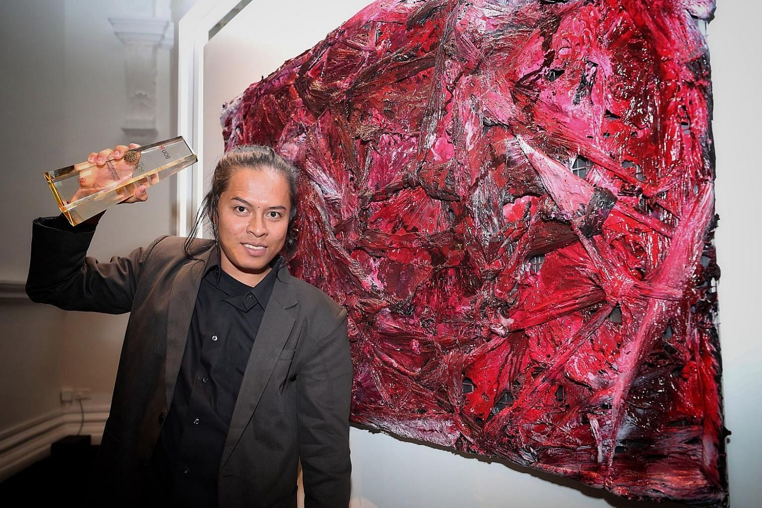 Suvi Wahyudianto (left) won the UOB South-east Asian Painting of the Year for Angs't (ANGST), while Khairulddin Abdul Wahab (above) won the UOB Painting of the Year (Singapore) for Rite Of Passage. The winning paintings will be exhibited at the UOB A