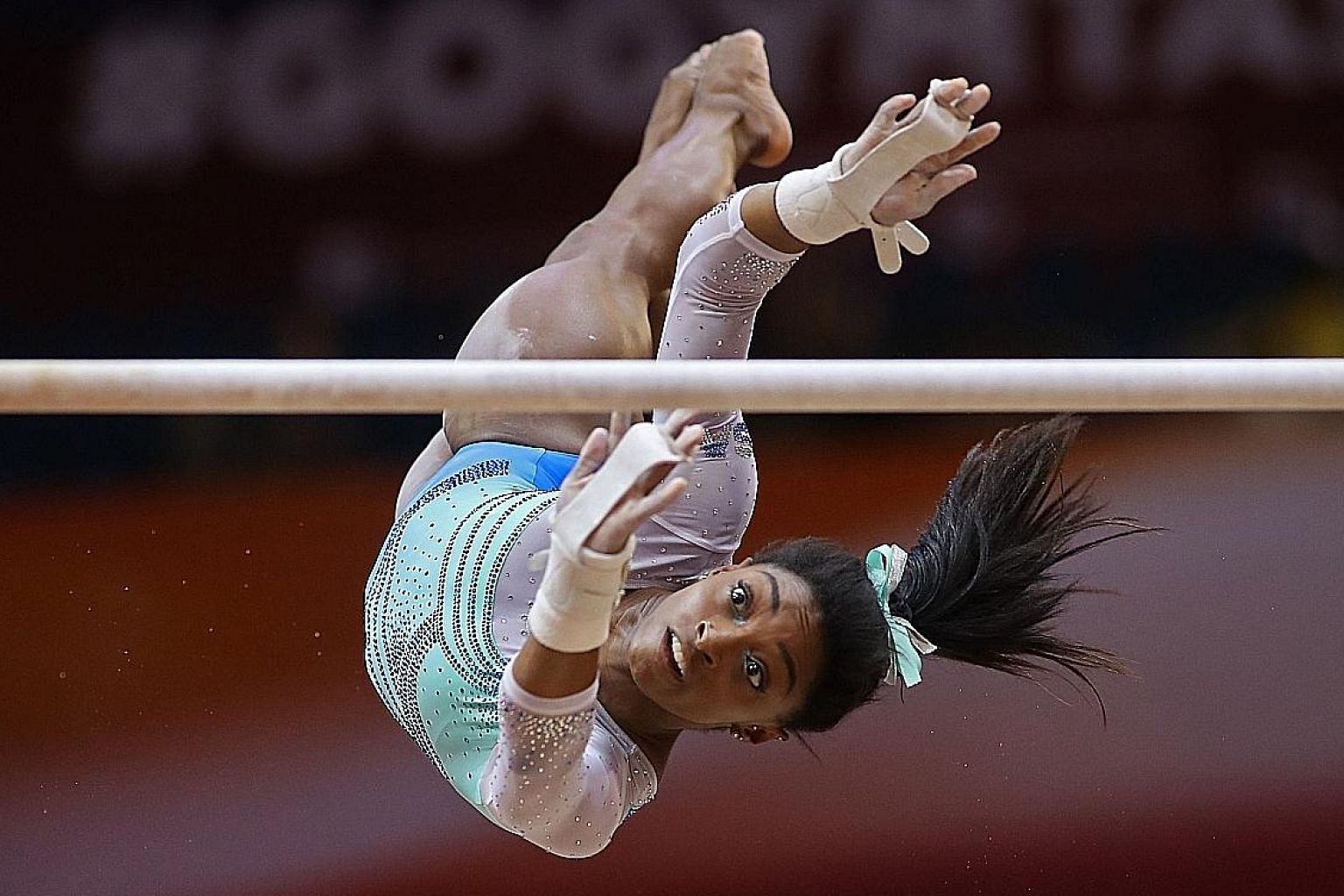 Despite falls on the balance beam and vault, Simone Biles proved too good as she won the all-around title at the World Gymnastics Championships in Doha on Thursday.