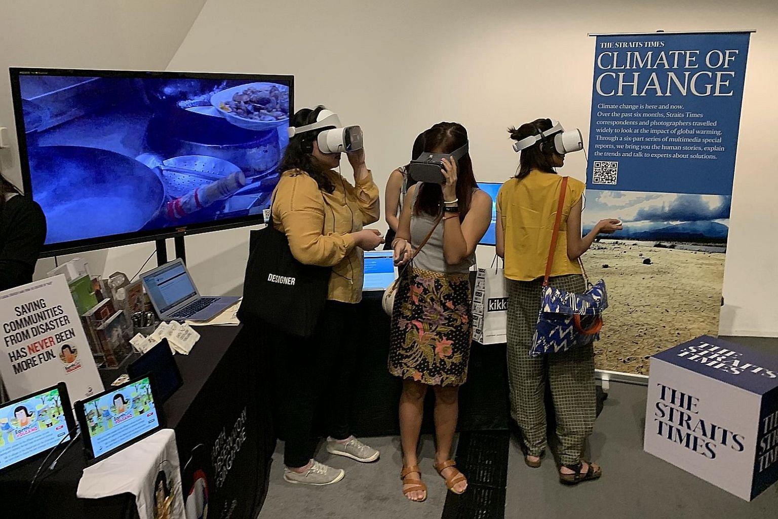 Visitors to The Straits Times' booth at the Singapore Eco-Film Festival can try out ST's VR project, which shows how climate change will affect Singapore, as they take a four-minute journey in 2100, from a river cruise at Boat Quay, to the Merlion Pa