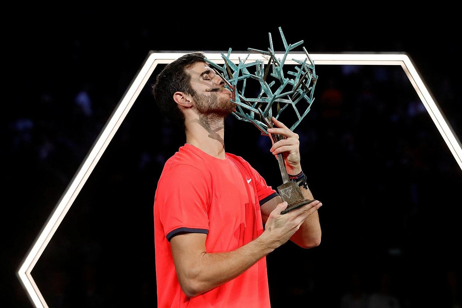 Russia's Karen Khachanov kissing his winner's trophy as he celebrates after overpowering Novak Djokovic 7-5, 6-4 in the Paris Masters final yesterday. The 22-year-old Russian has, for some time, been seen as one of the rising young talents of the spo