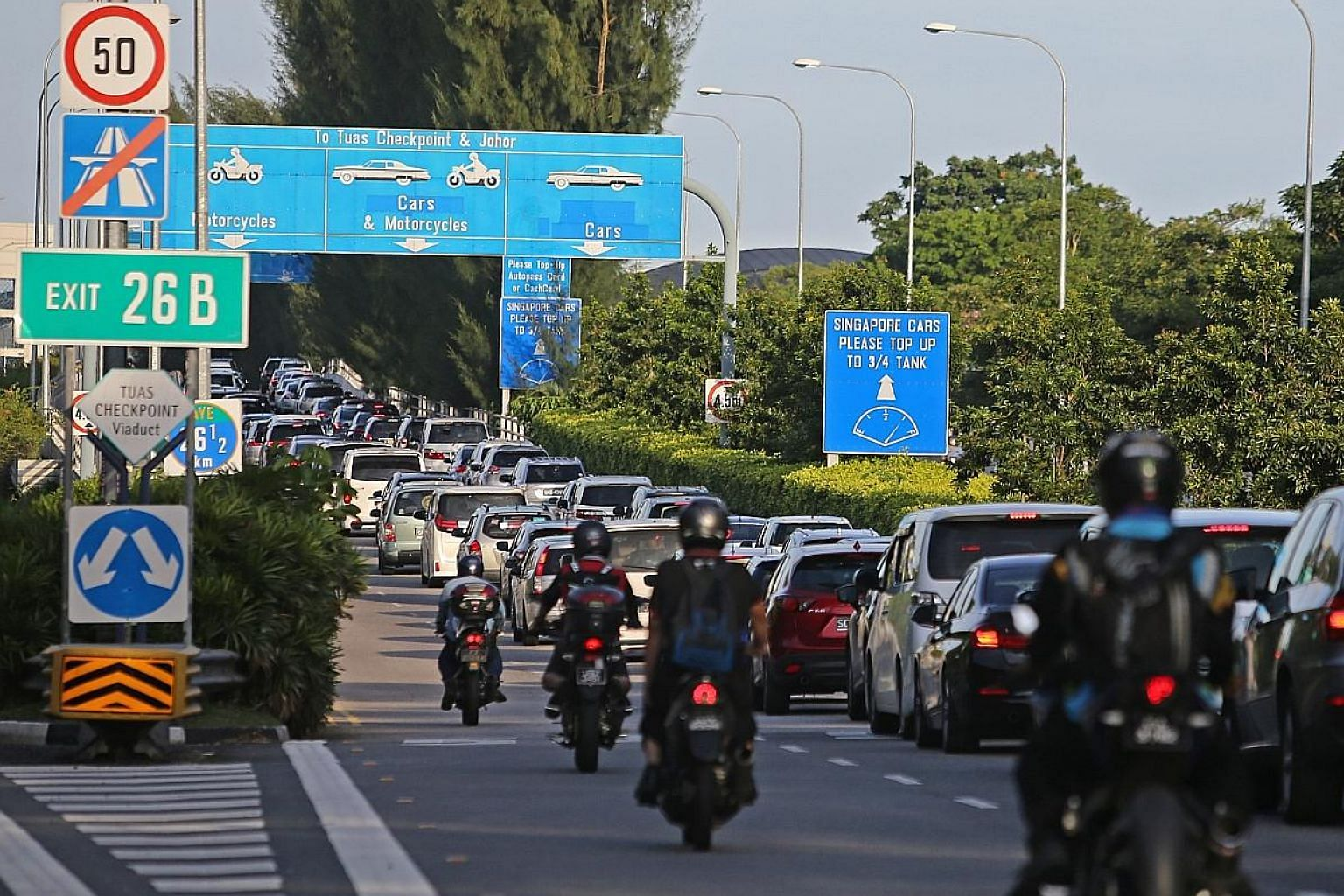 Motorcyclists currently pay RM1.10 (35 Singapore cents) on the Malaysian side of the Second Link and 40 cents at Tuas checkpoint. The Malaysian government has said that motorcyclists will get free passage across the Second Link to Singapore from Jan