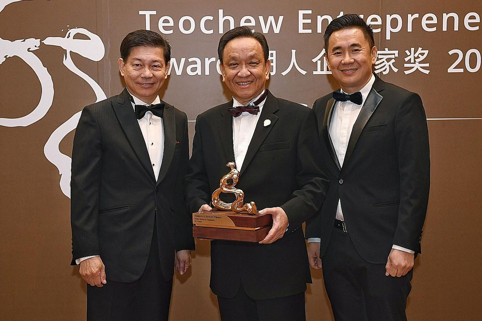 From left: Mr Ronald Lee, managing director of PrimeStaff Management Services; Mr Irman, president and CEO of Indonesia's Dima group; and Mr Stanley Yeo, founder of ZACD Group at the Asean Teochew Entrepreneur Award event. It is given out by the Teoc