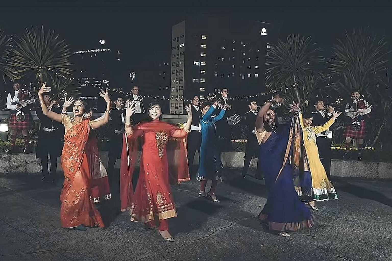 Top: The Deepavali video being performed by the Singapore Police Force. Above, from left: Staff Sergeant Priya Vamen, Deputy Superintendent Magdalene Ong and Sergeant Syafiqah Abdul Aziz sang most of the remixed Tamil song, which was subtitled in Eng