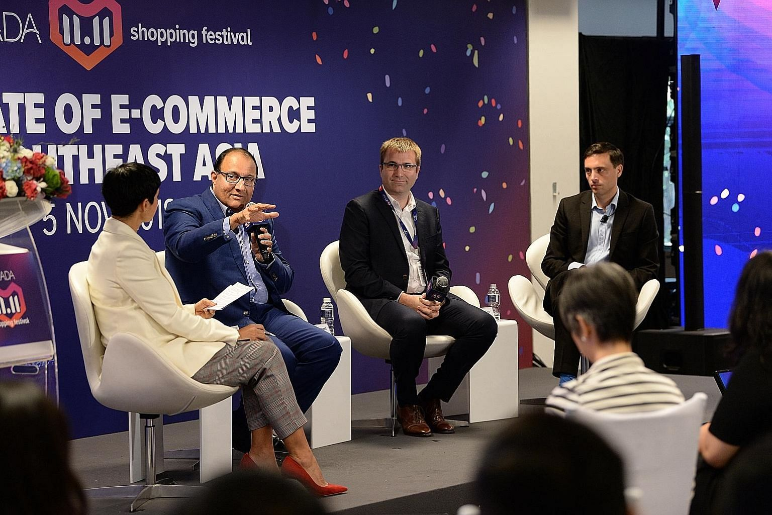 Communications and Information Minister S. Iswaran speaking at yesterday's panel discussion with (from left) media personality Anita Kapoor, Lazada Group executive president Pierre Poignant and Economist Intelligence Unit global chief economist Simon