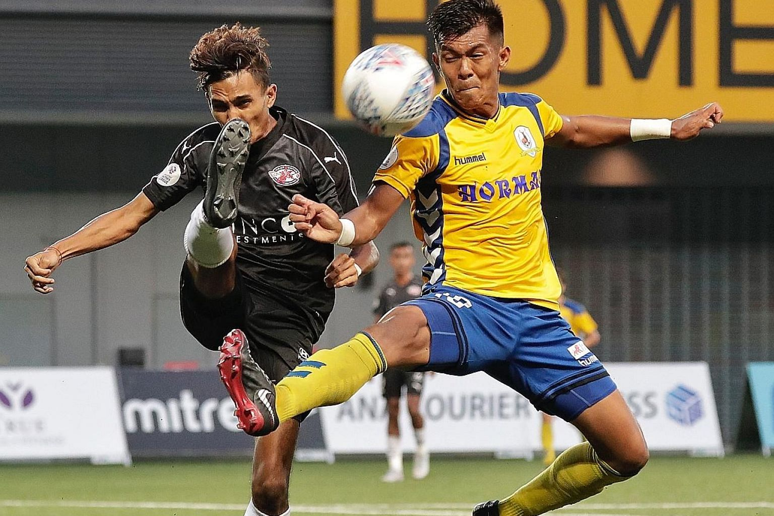 Tampines Rovers' Khairul Amri (right) challenges Home United's Aqhari Abdullah for the ball during a Singapore Premier League match on Sept 29. Average attendance jumped to 1,800 this year from just below 1,000 last year.