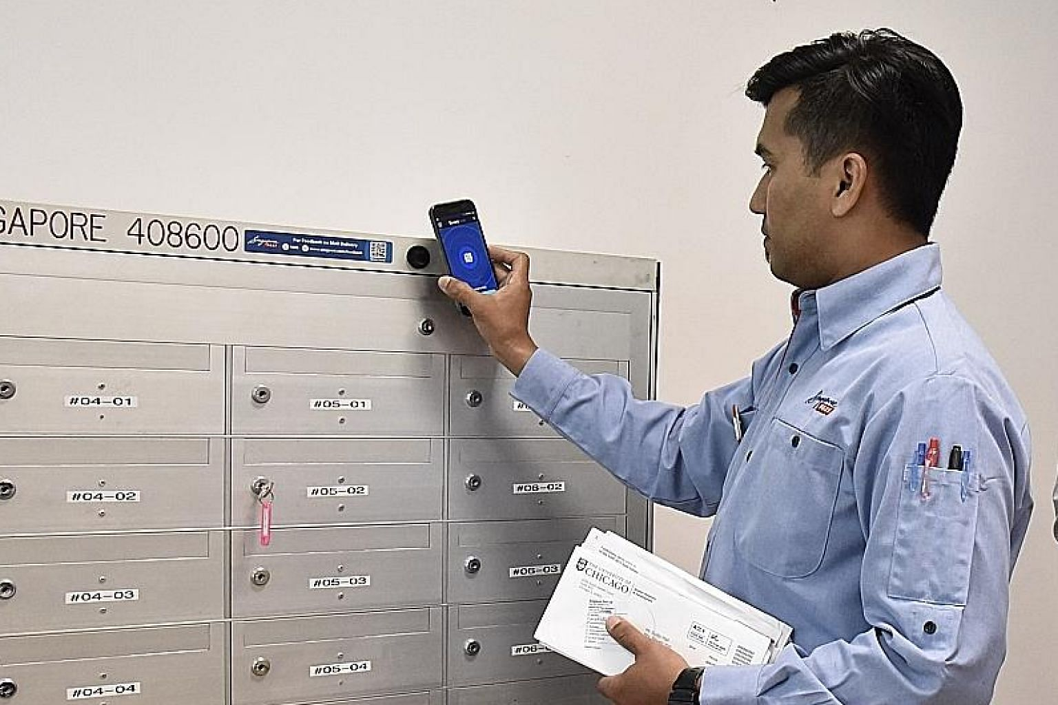 Left: All of SingPost's 1,000 postmen will use a mobile app for deliveries from January next year. Above: The app helps in tracking delivery and e-signing for registered mail.