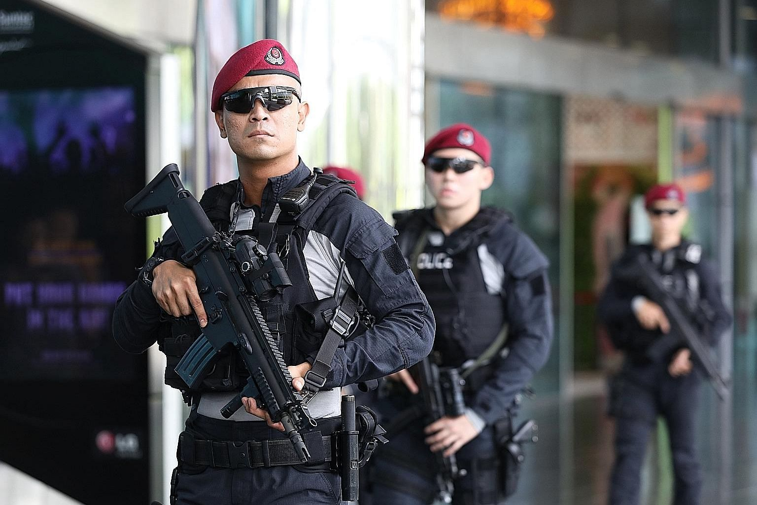 Officers from the Special Operations Command (above) were seen yesterday patrolling around Suntec Singapore Convention and Exhibition Centre where the 33rd Asean Summit is to take place next week. Mobile surveillance cameras (below) were also seen ne