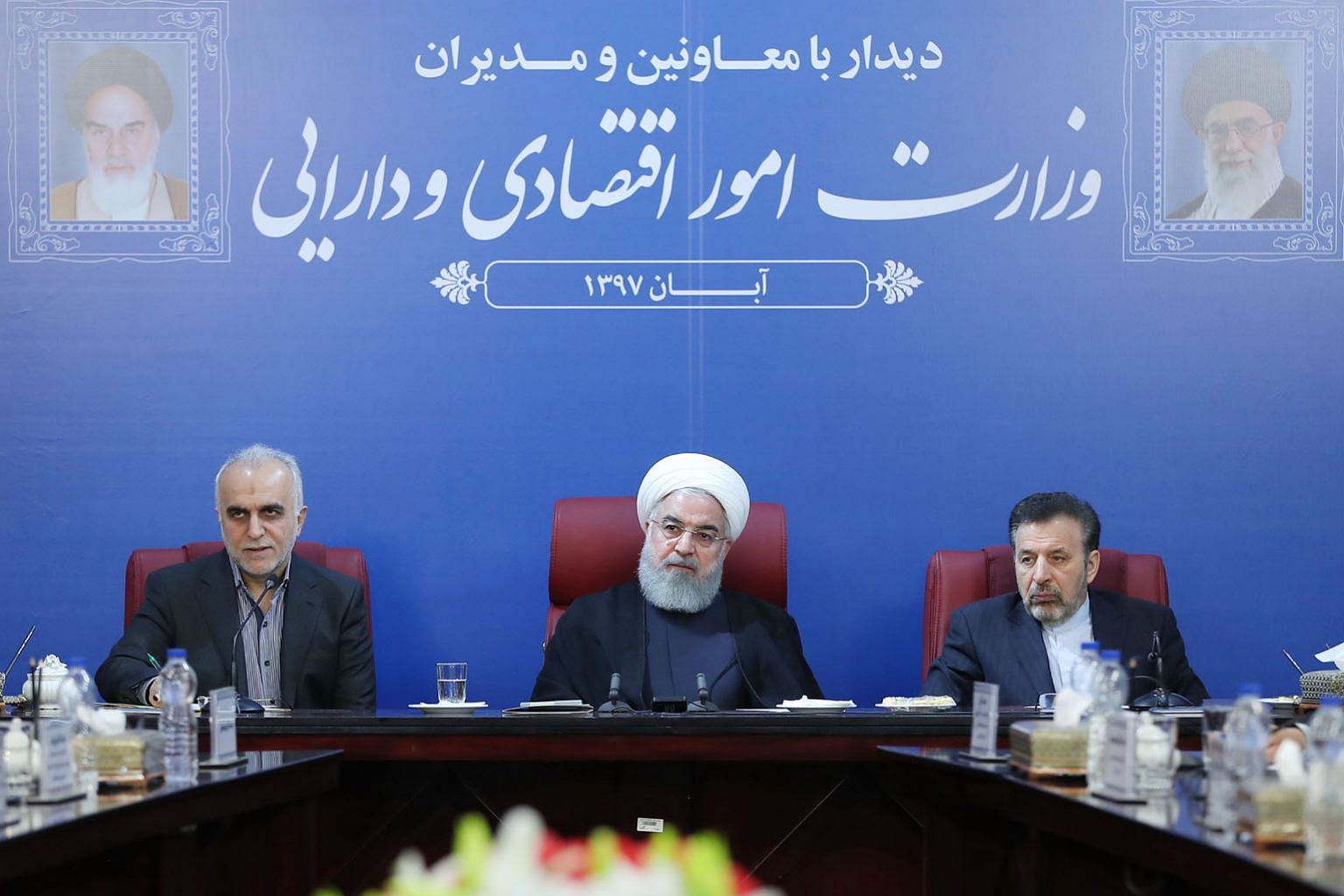 "Iran's President Hassan Rouhani (centre) at a Cabinet meeting in the capital Teheran. He said the country is ""in a situation of economic war, confronting a bullying power"", as sanctions by the US took effect yesterday."