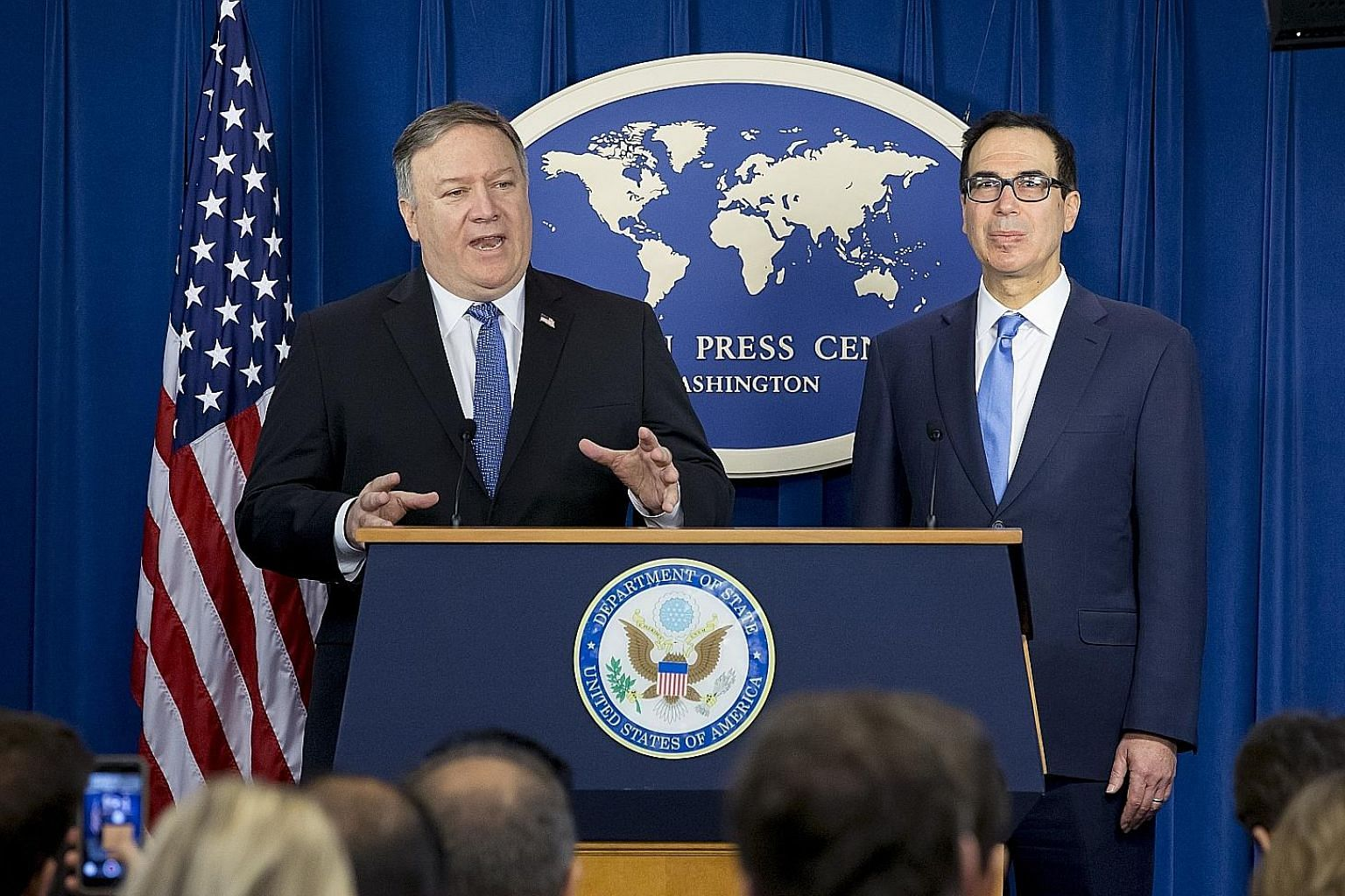 US Secretary of State Mike Pompeo (left) and Treasury Secretary Steven Mnuchin at Monday's media briefing on the wide sanctions against Iran. Analysts say this round of penalties is not an existential threat to Teheran.