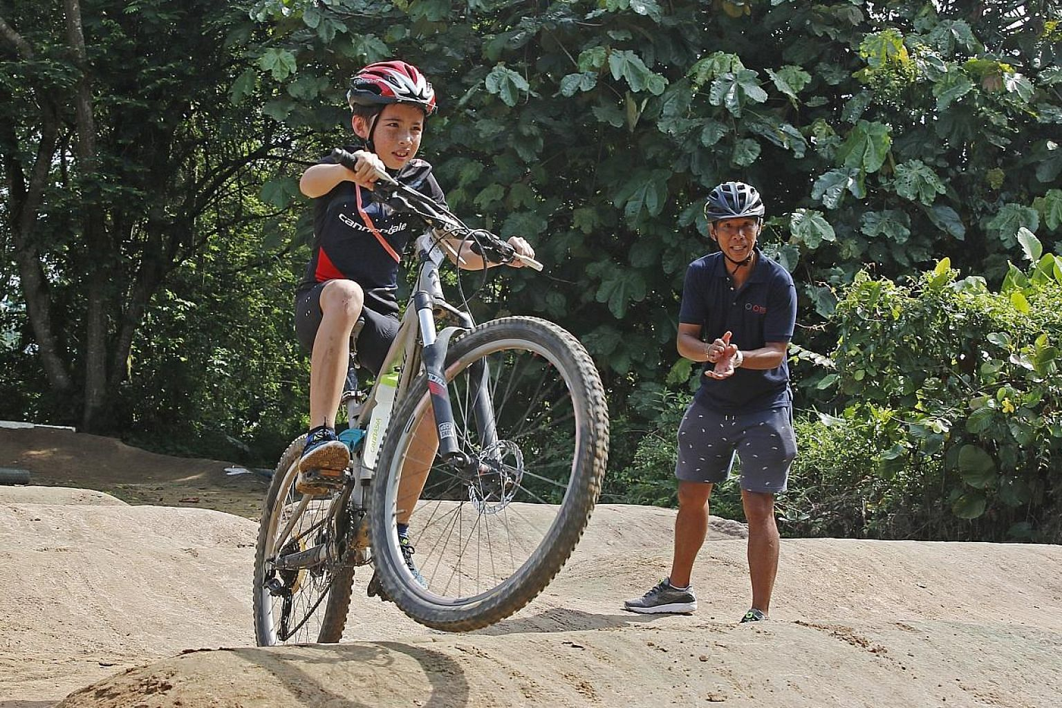 Some 50 children experienced off-road riding at a clinic to mark the Singapore Cycling Federation's launch of its youth development academy at Turf City's Centaurs Sports Park yesterday.