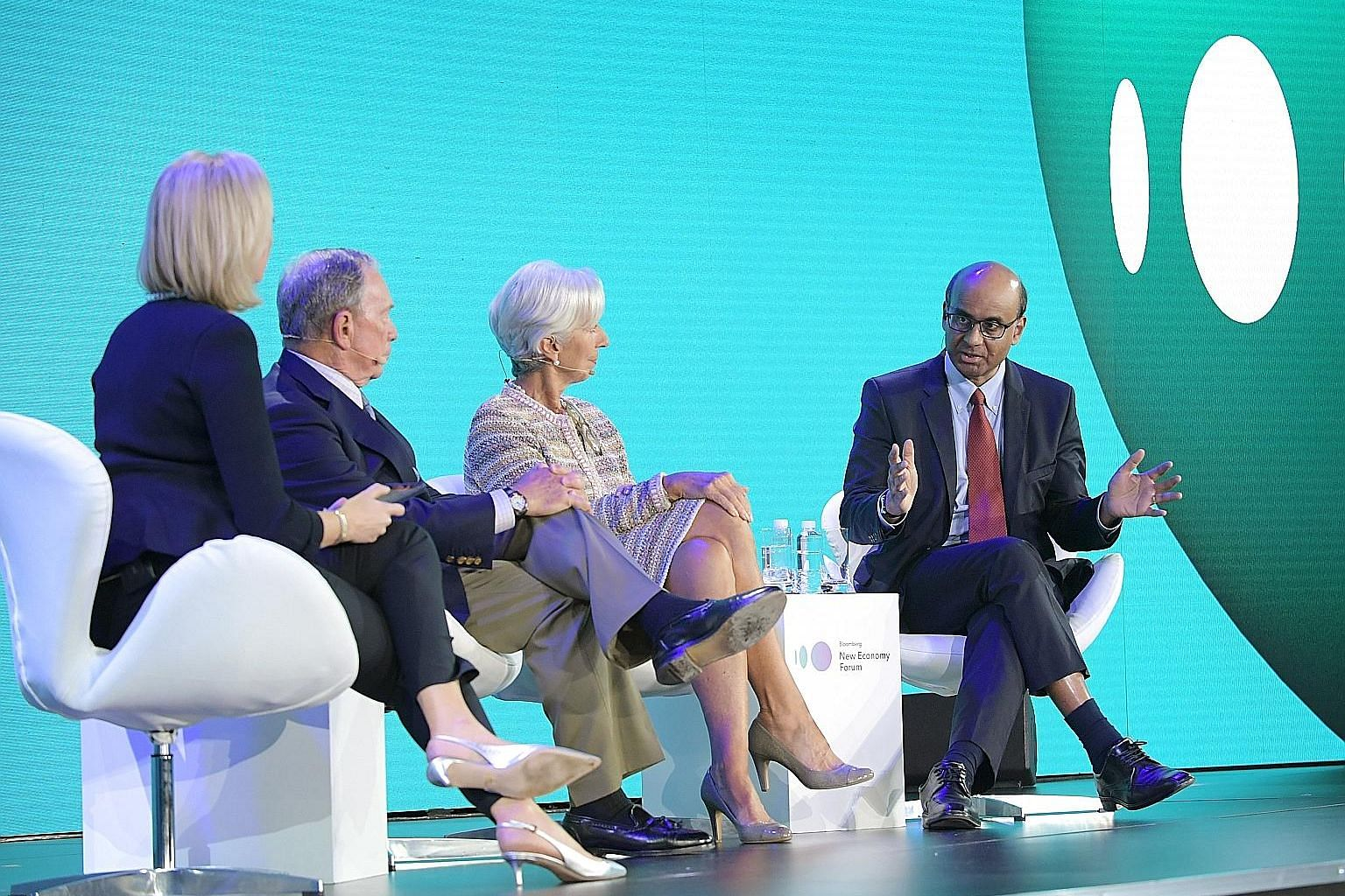 Deputy Prime Minister Tharman Shanmugaratnam sharing his views at a panel discussion yesterday at the Bloomberg New Economy Forum. With him are (from left) moderator and Bloomberg TV editor-at-large Francine Lacqua, former New York mayor Michael Bloo