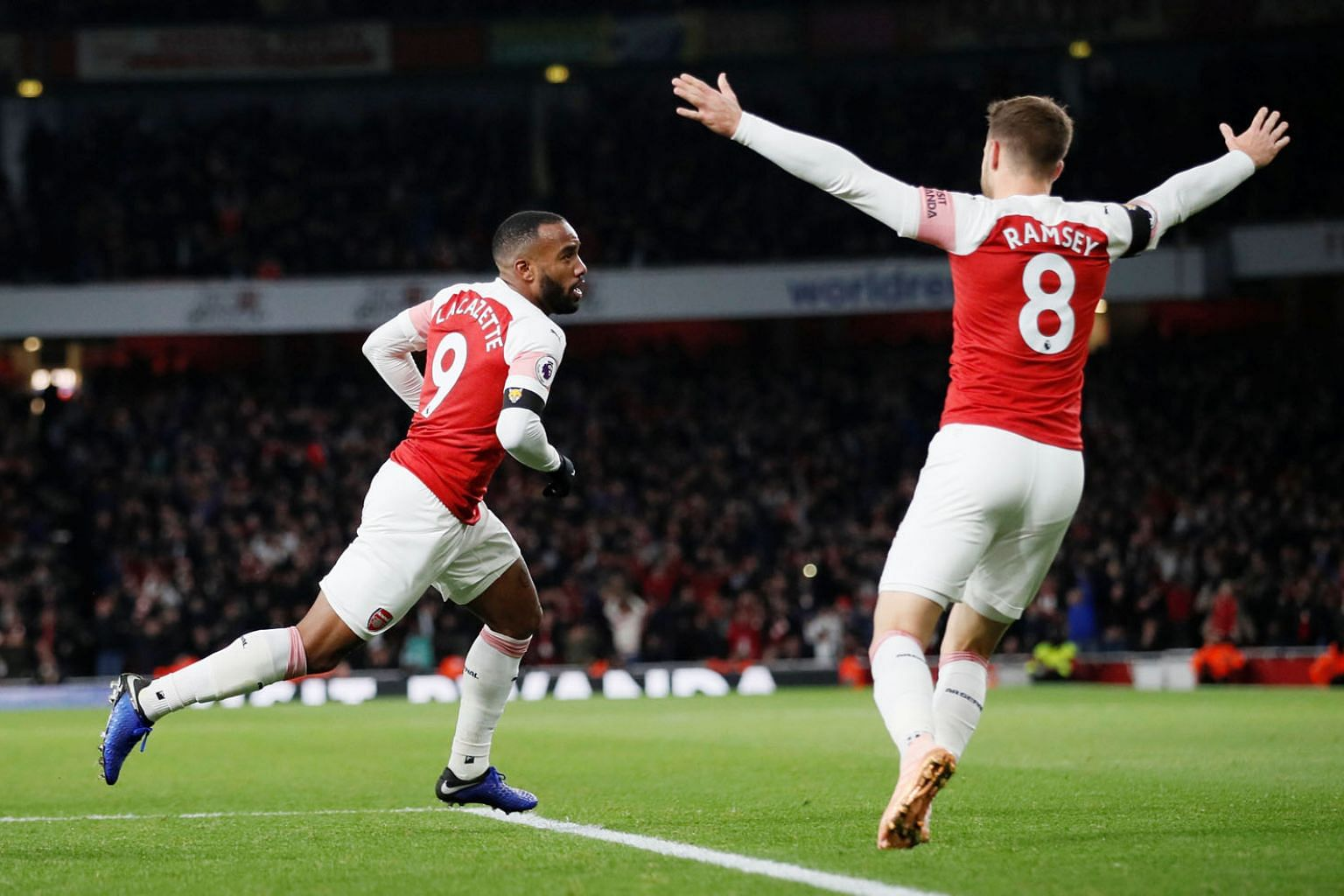 Arsenal forward Alexandre Lacazette celebrates with teammate Aaron Ramsey after scoring the equaliser in the 1-1 draw with Liverpool at the Emirates Stadium on Saturday. Goalkeeper Bernd Leno said the result proved the Gunners can hold their own agai