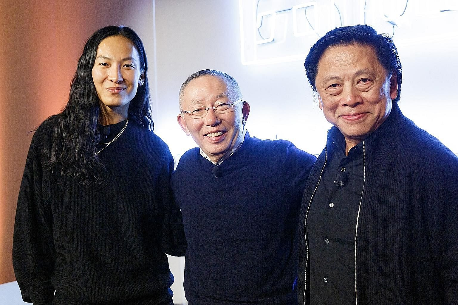The Uniqlo x Alexander Wang collection of 16 products includes a sleeveless bodysuit ($49.90, left) for women and a tank top ($19.90) and pair of tights ($49.90, both right) for men. (From left) Designer Alexander Wang, Fast Retailing Group chief exe