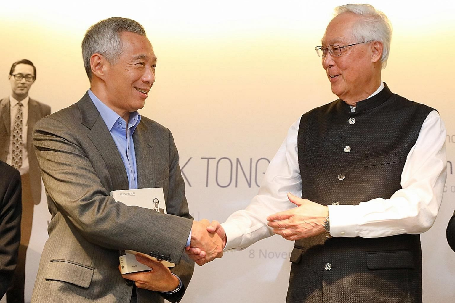 Prime Minister Lee Hsien Loong with Emeritus Senior Minister Goh Chok Tong at yesterday's launch of Tall Order: The Goh Chok Tong Story, which PM Lee said is particularly timely as a major theme in it is leadership renewal, and the next team to lead