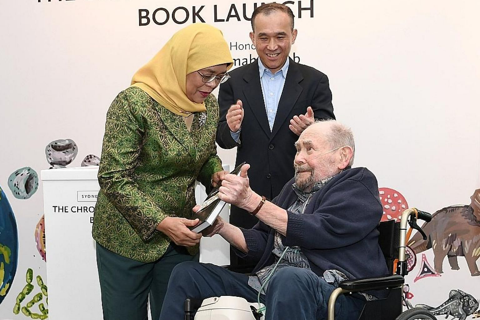 President Halimah Yacob and A*Star chairman Lim Chuan Poh at the book launch of Sydney Brenner's 10-On-10: The Chronicles Of Evolution, the brainchild of Nobel laureate Sydney Brenner.