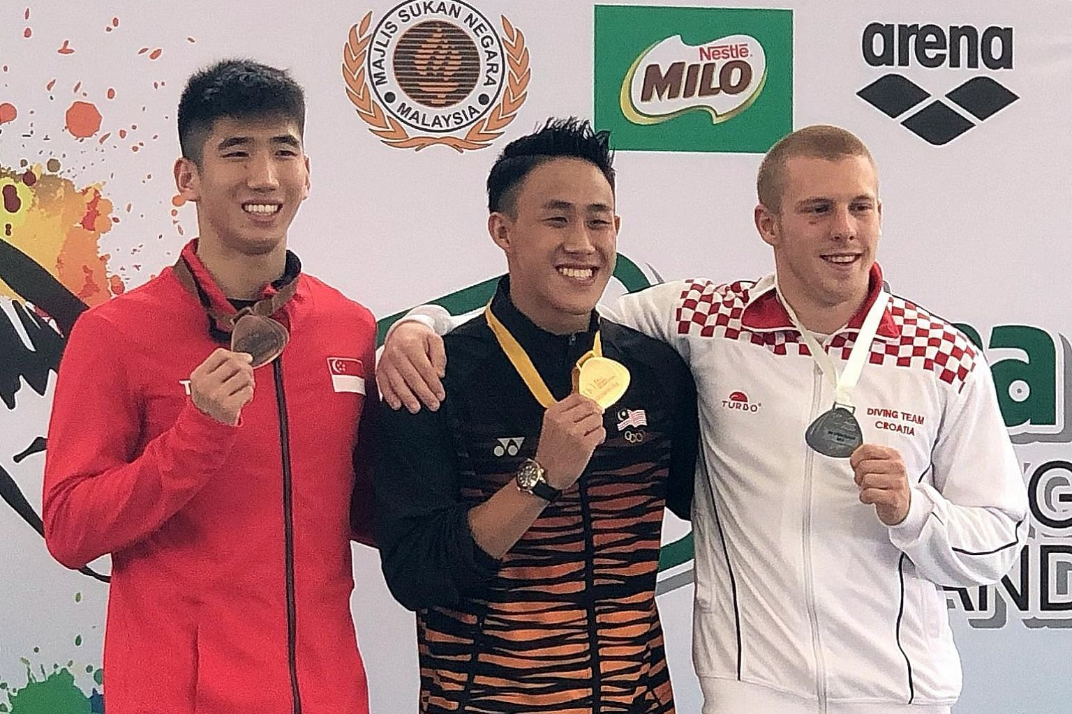 Timothy Lee with his men's 3m springboard bronze at the Fina Diving GP in KL. Ooi Tze Liang won gold and Croatia's Hrvoje Brezovac silver.