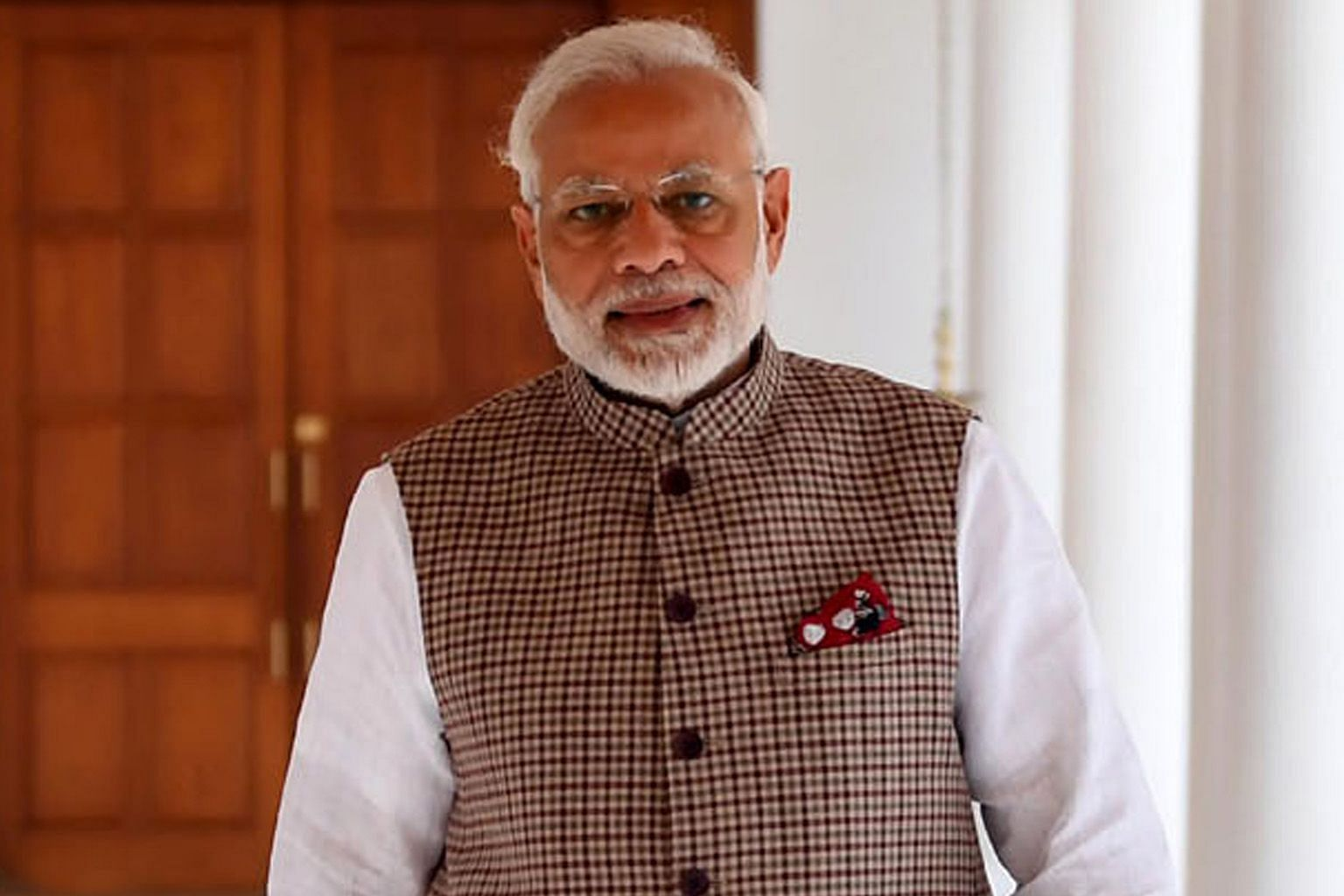 Indian Prime Minister Narendra Modi (far left) wears the jacket in various colours. His is cut longer and in a comfortable fit. The country's first prime minister, Jawaharlal Nehru, wore the jacket in more muted colours. South Korean President Moon J