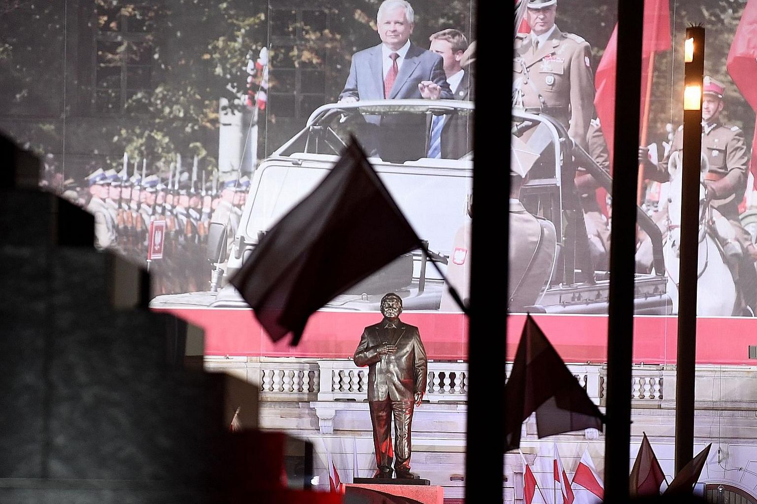 Mr Jaroslaw Kaczynski (centre, on screen), chairman of Poland's ruling Law and Justice party, at a ceremony to unveil a monument of his twin brother, the late Polish president Lech Kaczynski, last Saturday.