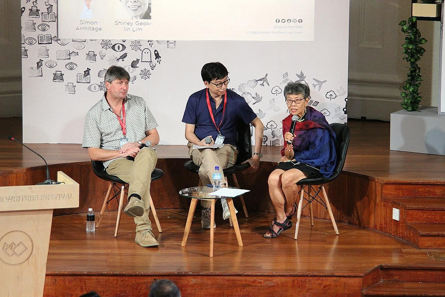 (From far left) British poet Simon Armitage, moderator and writer Gwee Li Sui and Malaysia-born American poet Shirley Geok-lin Lim at the lecture, Across The Universe: Three Poets Address The State Of The World, at the Singapore Writers Festival.