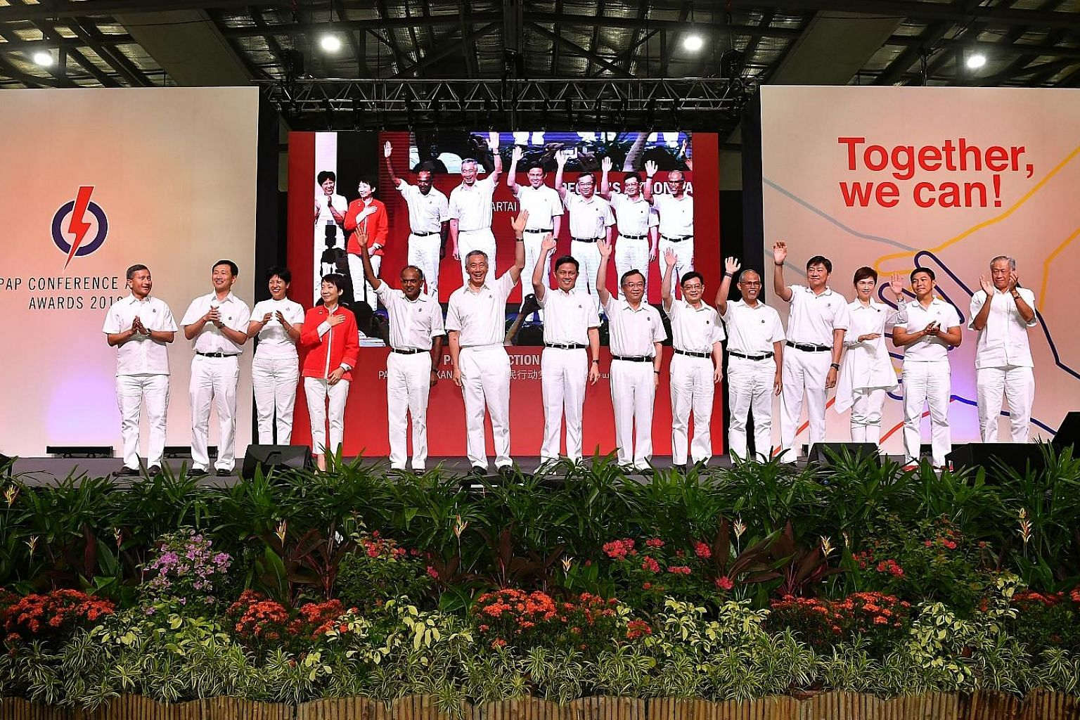 Prime Minister Lee Hsien Loong with the new line-up of People's Action Party central executive committee members elected and co-opted at the party conference yesterday. With him are (from left) Foreign Minister Vivian Balakrishnan; Education Minister