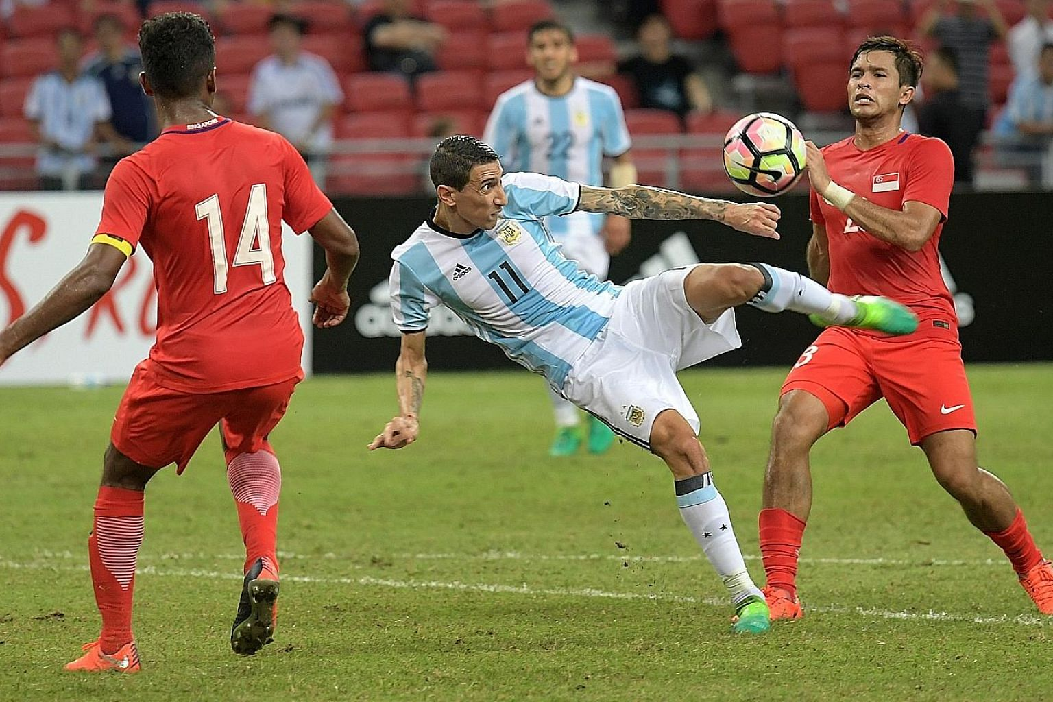 Angel di Maria attempting a shot while being marked by Hariss Harun (left) and Zulfahmi Arifin in their friendly last year. Issues over FAS' claim arose from this match and efforts to revive the deal were hampered by MPS' troubles.