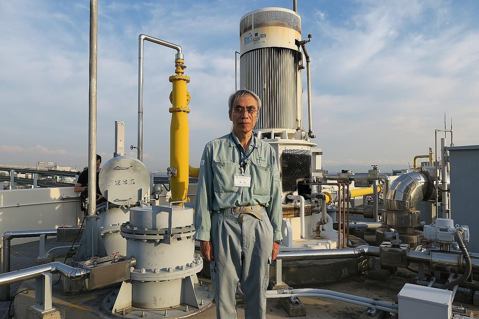 Mr Takashi Kusuda, an employee at the Higashinada sewage treatment plant, in front of a facility that refines city sewage into biogas.