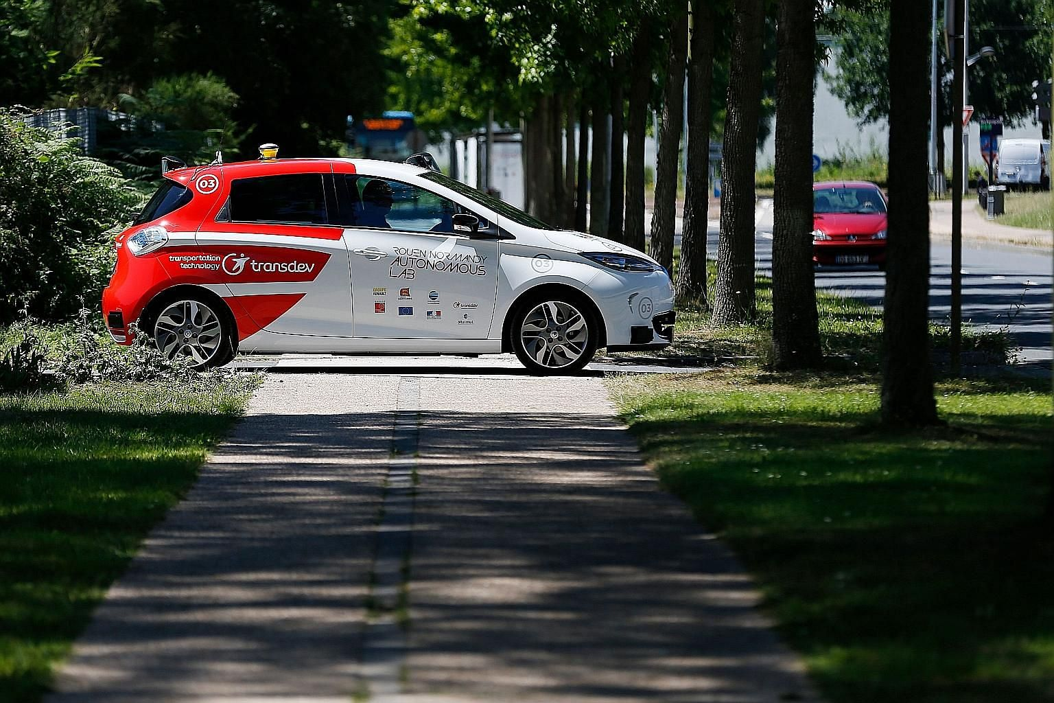 An autonomous car at a press presentation in the French city of Sotteville-les-Rouen earlier this year. Legal questions from traffic rules to liability in an accident ultimately will determine whether consumers decide if they canlive with driverl