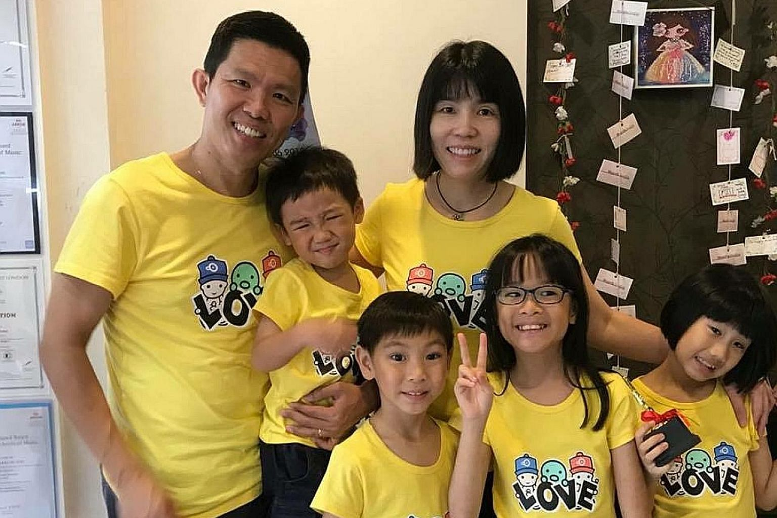 Mr Dickson Lim, 49, and his wife Allison Chong, 43, adopted their four children when they were newborn without asking to see their photos. Today, (from left) Alan is four; Daryl, six; Dawn, nine; and Amanda, eight. They attend student care and childc