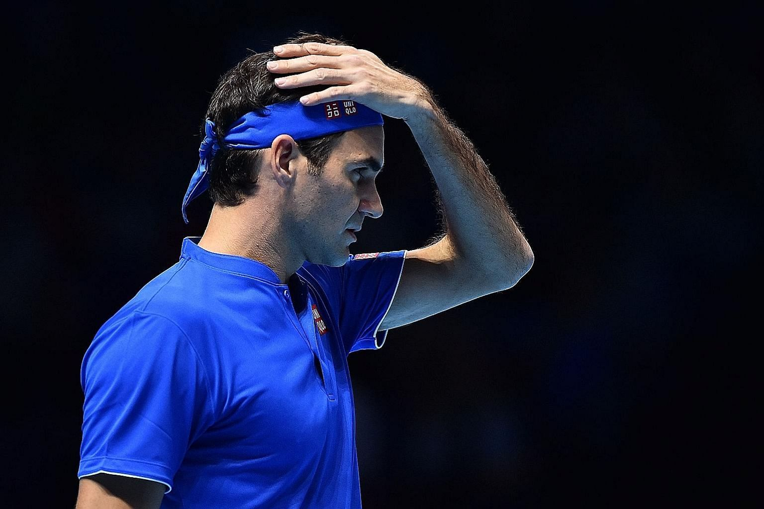 Roger Federer searching for answers during his 7-6 (7-4), 6-3 loss to Kei Nishikori in the ATP Finals on Sunday. The normally cool Swiss was warned for ball abuse in the first set.