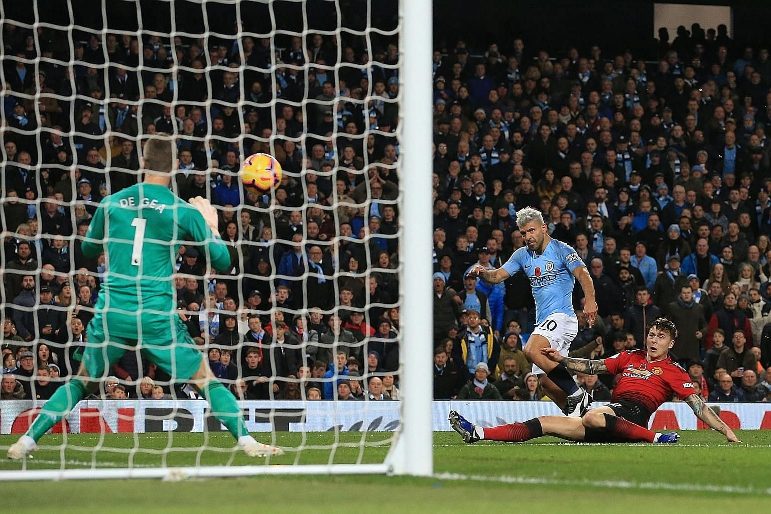 City striker Sergio Aguero beating United defender Victor Lindelof to score past goalkeeper David de Gea and put the hosts 2-0 up in the Manchester derby on Sunday. Anthony Martial netted a spot kick for his team's only shot on target but Ilkay Gundo