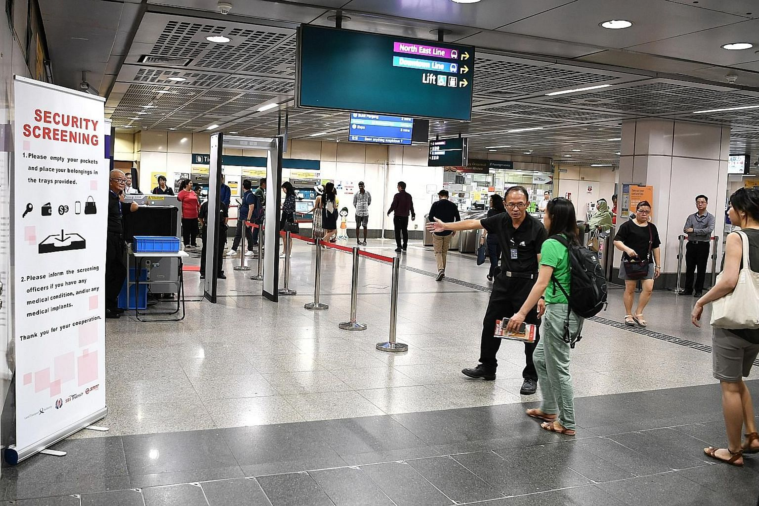 A commuter at Little India MRT station being directed to go through a security screening on the first day of the trial yesterday. The Land Transport Authority said the trial will be conducted at up to six stations across the rail network and that not