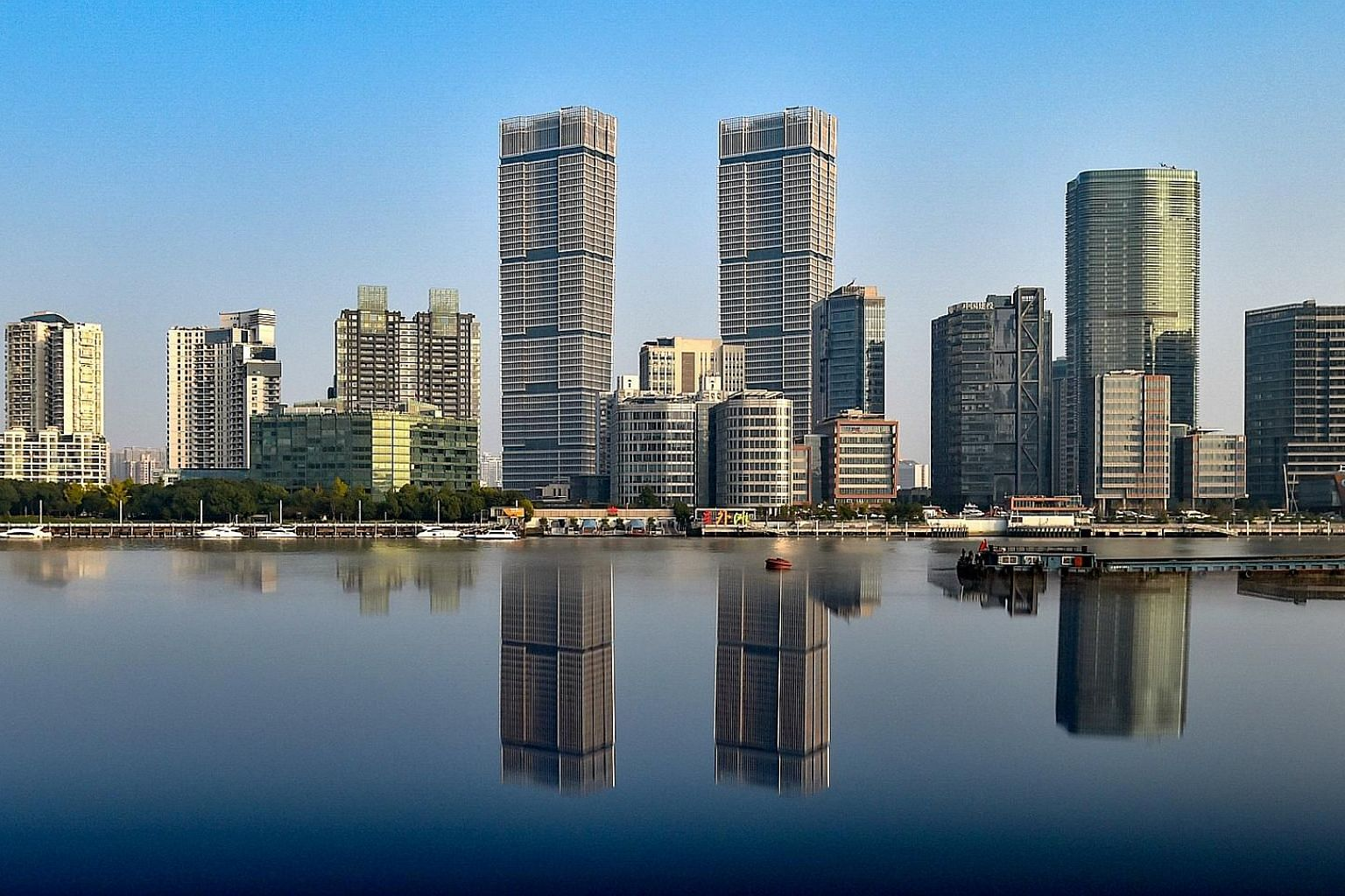 CapitaLand, through Raffles City China Investment Partners III, formed a 50:50 joint venture with GIC to acquire the twin towers, which sit on 4.05ha along Huangpu River in North Bund, and soar 263m above the fast-growing business district. The purch