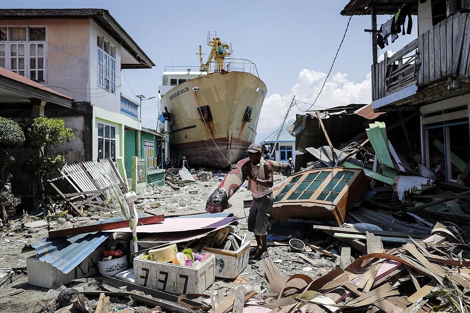 A stranded ship in Central Sulawesi, Indonesia, after a series of powerful earthquakes hit the area on Sept 28, triggering a tsunami. Almost 3,000 people were killed in Indonesia in the last three months or so from earthquakes, aftershocks and a Lion
