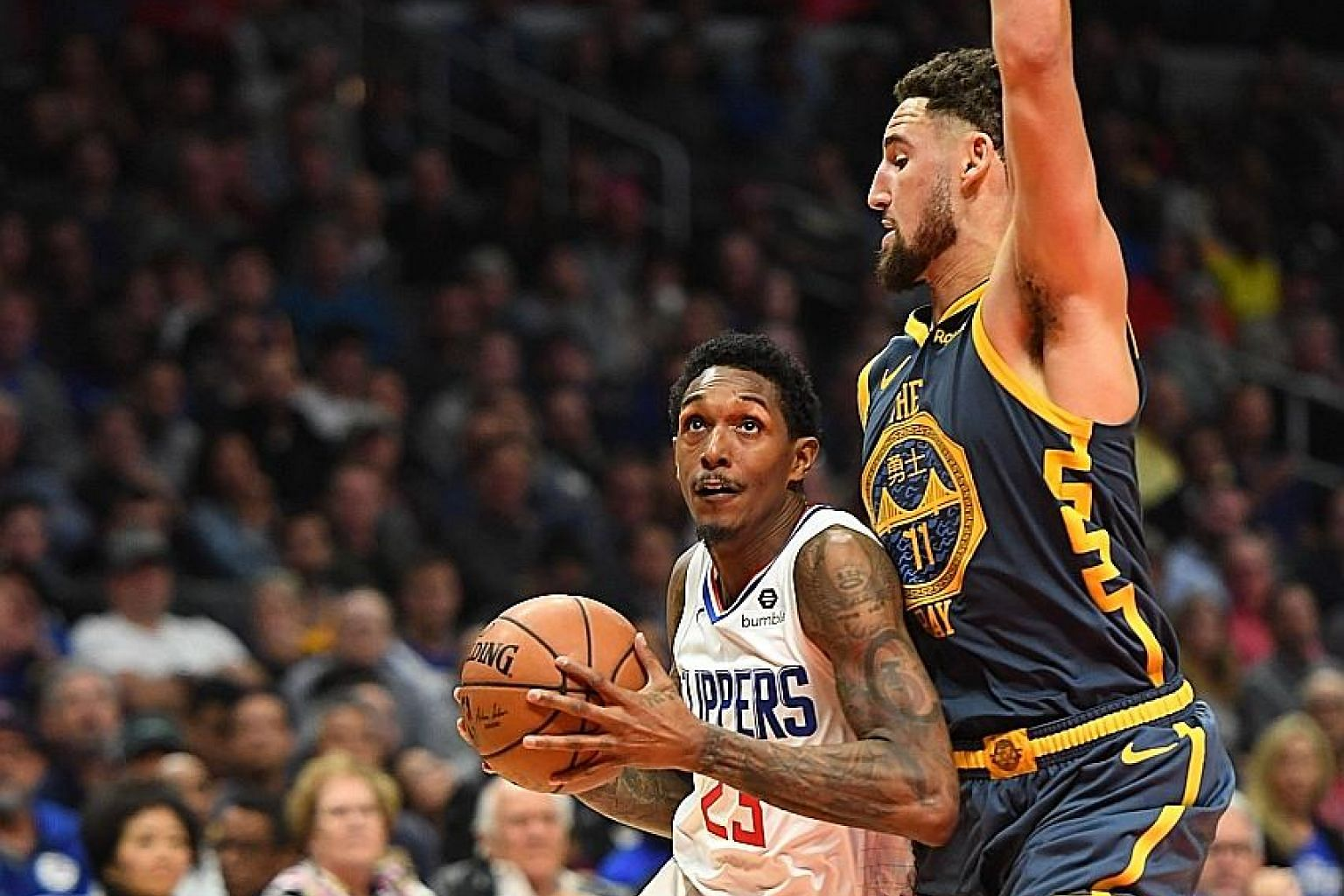 Clippers guard Lou Williams driving to the basket in overtime at Staples Centre as Warriors guard Klay Thompson defends. Williams scored 10 of his 25 points in the extra period as the visitors won 121-116.