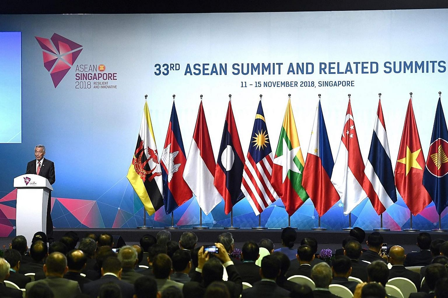 Prime Minister Lee Hsien Loong speaking at yesterday's opening ceremony of the 33rd Asean Summit - the final milestone of Singapore's year as the grouping's chair.