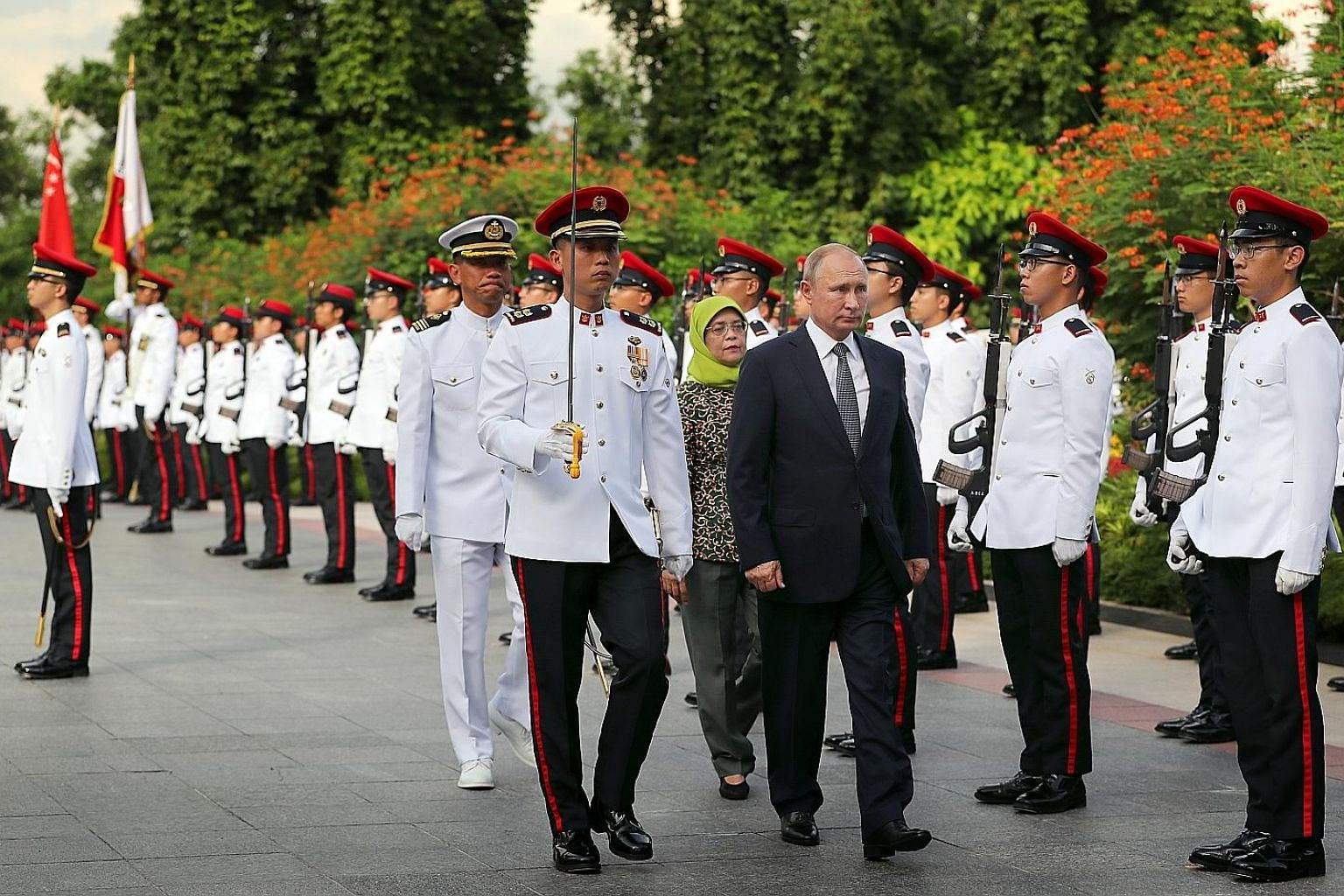 Russian President Vladimir Putin reviewing the guard of honour with Singapore President Halimah Yacob at the Istana yesterday. Singapore President Halimah Yacob and Russian President Vladimir Putin unveiling the cornerstone yesterday at the groundbre