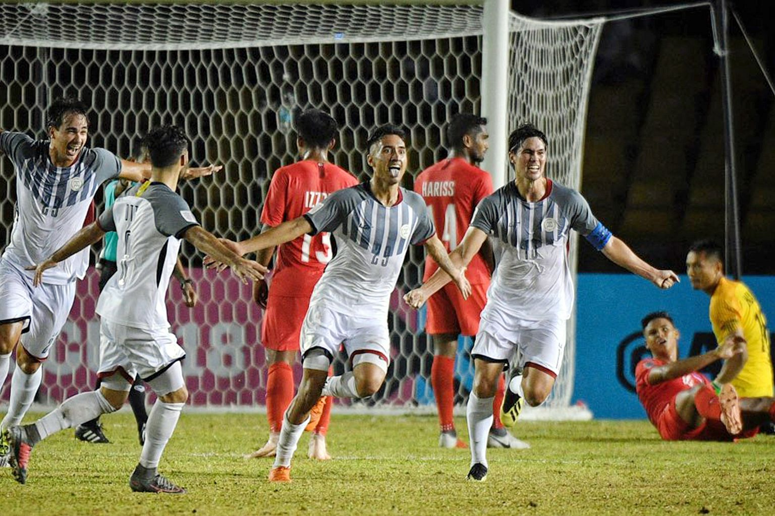Patrick Reichelt (second from right) celebrating with his Philippine teammates after scoring the only goal of the game against Singapore at the Panaad Stadium in Bacolod.