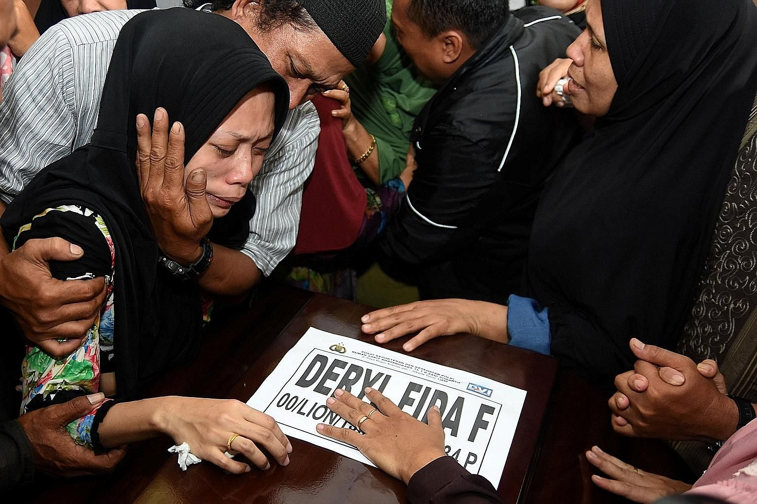 Ms Lutfinani Eka Putri, the wife of a Lion Air Flight JT610 passenger, reacting to the arrival of her husband's coffin in Surabaya on Tuesday.