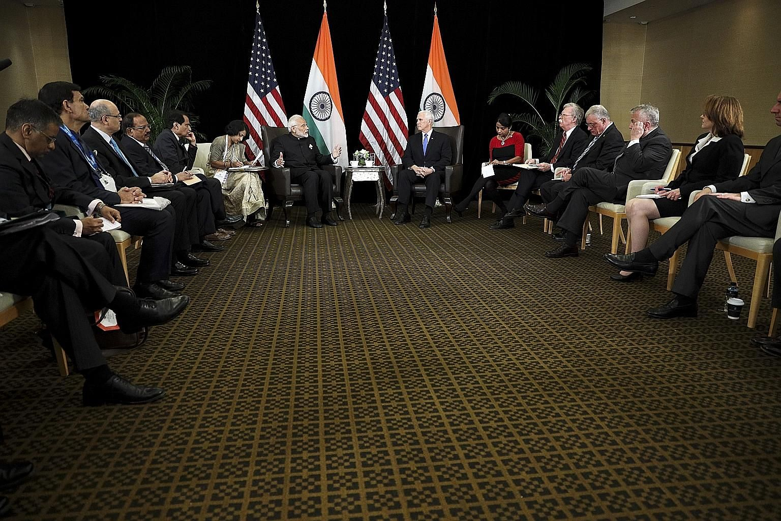 Indian Prime Minister Narendra Modi (centre, left) and US Vice-President Mike Pence attending a bilateral meeting yesterday held on the sidelines of the Asean Summit. During the meeting, Mr Pence and Mr Modi stressed the importance of the US-India st
